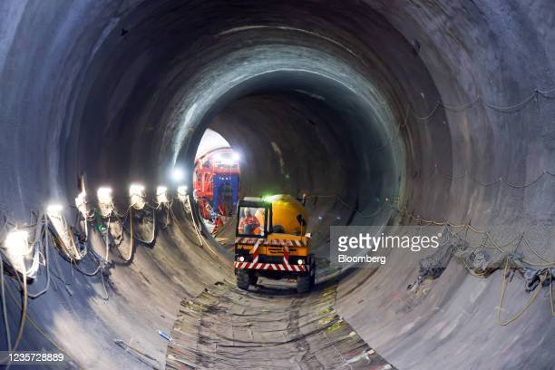 An employee drives a cement mixer through the main tunnel at the Thames Tideway Tunnel super sewer construction project in London, U.K., on...