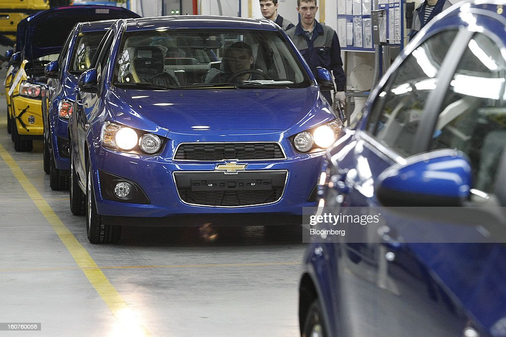An employee drives a completed Chevrolet Aveo automobile, a division of General Motors Co. (GM), off the production line at the GAZ Group plant in Niznhy Novgorod, Russia, on Tuesday, Feb. 5, 2013. GAZ, which is controlled by Russian billionaire Oleg Deripaska, plans to make 30,000 Aveo sedans and hatchbacks a year at its plant in Nizhny Novgorod starting in mid-2012. Photographer: Alexander Zemlianichenko Jr./Bloomberg via Getty Images