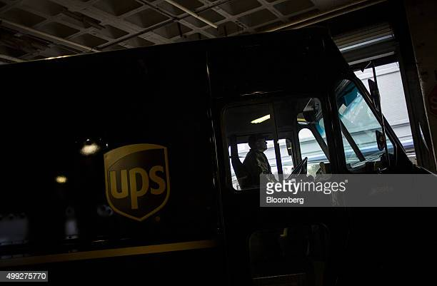 An employee drives a delivery truck out of a United Parcel Service Inc distribution facility on Cyber Monday in New York US on Monday Nov 30 2015...
