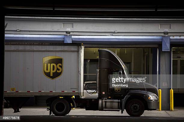 An employee drives a tractor trailer out of a United Parcel Service Inc distribution facility on Cyber Monday in New York US on Monday Nov 30 2015...