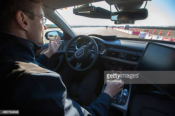 An employee drives an Audi A6 diesel automobile produced by Volkswagen AG handsfree during an automated driving exercise on a test track at the new...