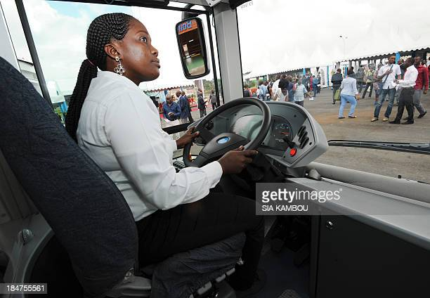 An employee drives one of the two electric buses constructed by French electric car battery manufacturer Bollore on October 16 on the campus of the...