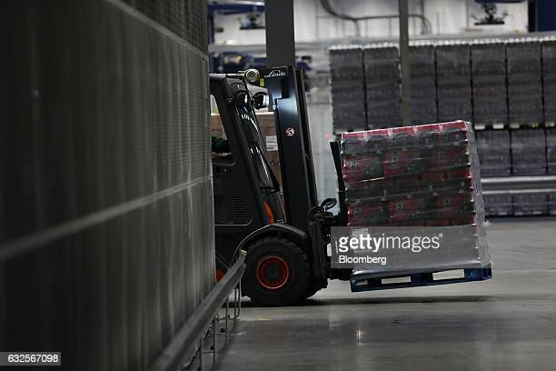 An employee driving a forklift truck moves a pallet of J2O soft drinks at the Britvic Plc factory and warehouse in Leeds UK on Monday Jan 23 2017...