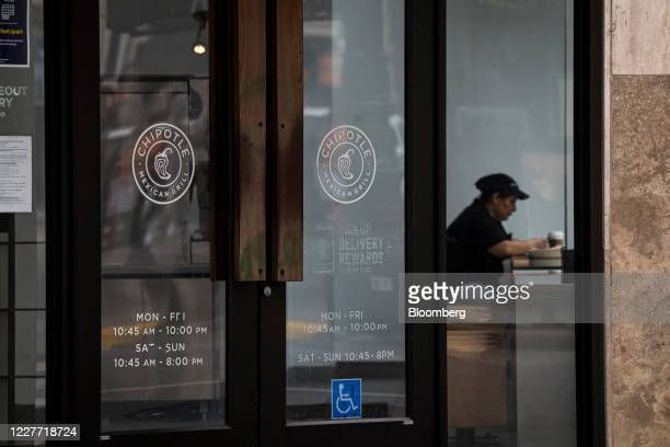 An employee eats inside a Chipotle Mexican Grill Inc restaurant in San Francisco California US on Monday July 20 2020 Chipotle is scheduled to...