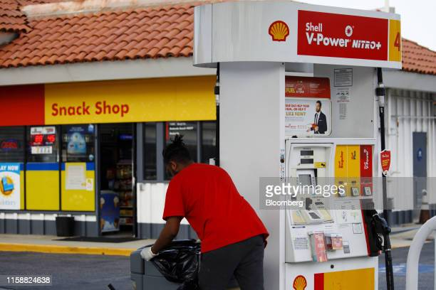 An employee empties trash cans at a Royal Dutch Shell Plc gas station in Redondo Beach California US on Sunday July 28 2019 Royal Dutch Shell is...