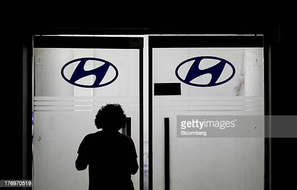 An employee enters an office at the Hyundai Motor Co. Plant during a strike by the company's labor union in Ulsan, South Korea, on Tuesday, Aug. 20,...