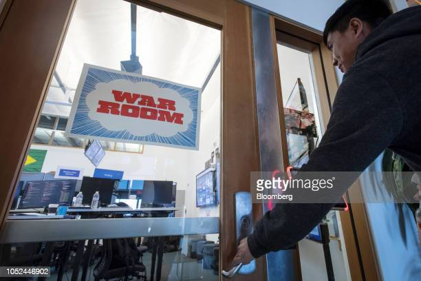An employee enters the War Room ahead of Brazil's runoff election at Facebook Inc headquarters in Menlo Park California US on Wednesday Oct 17 2018...