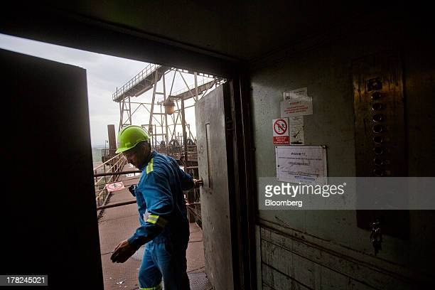 An employee exits a lift onto a walkway above ArcelorMittal's steel plant in Ostrava, Czech Republic, on Monday, Aug. 26, 2013. ArcelorMittal, the...