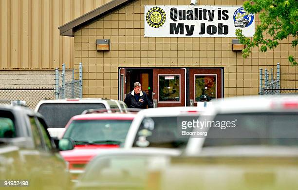 An employee exits the General Motors Pontiac Assembly Plant in Pontiac Michigan US on Monday June 1 2009 The plant is one of 12 that General Motors...