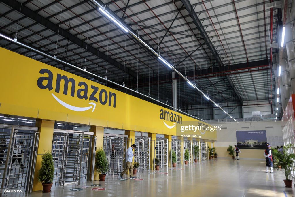 An employee exits the warehouse floor of the Amazon.com Inc. fulfillment center in Hyderabad, India on Thursday, Sept. 7, 2017. Amazon opened its largest Indian fulfillment center in Hyderabad. The center spans 400,000 square feet with 2.1m cubic feet of storage capacity the company said in a statement. Photographer: Dhiraj Singh/Bloomberg via Getty Images