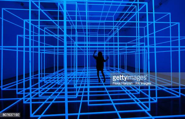 An employee experiences an installation by Antony Gormley Breathing Room III at the White Cube Gallery in London it is comprised of photoluminescent...