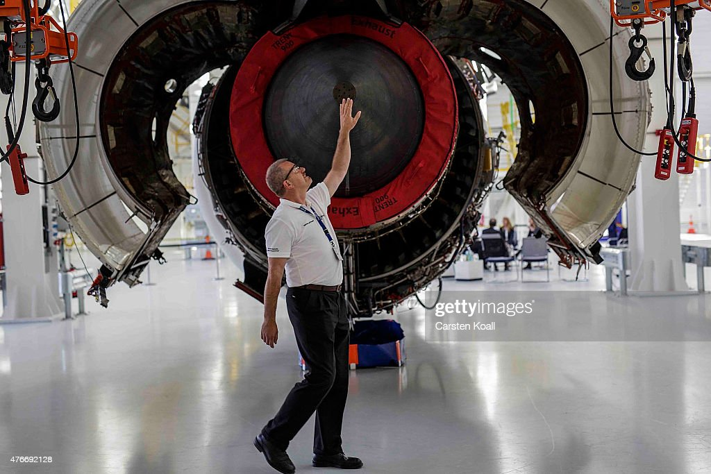 An employee explains a jet engine after German President Joachim Gauck visits the Rolls-Royce Mechanical Testing Operations Center on June 11, 2015 near Berlin, Germany. Gauck was visiting the center to learn about its integration of immigrants among its workforce.