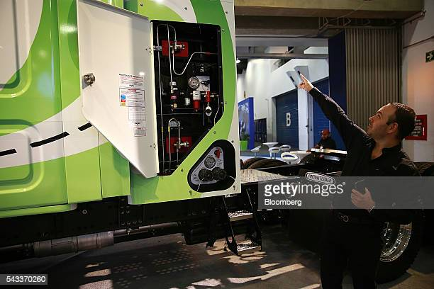 An employee explains the use of compress natural gas on a Daimler AG Cascadia Freightliner truck during the Made in Germany Technology Science and...