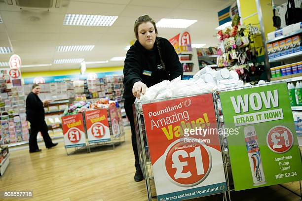 An employee fills wire basket bins with toiletries at a Poundland Group Plc store in Leigh UK on Thursday Feb 4 2016 UK like for like sales at...
