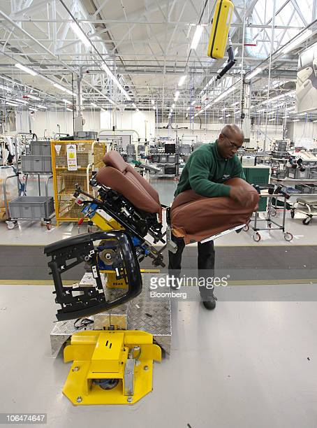 An employee fits the leather to a Bentley Mulsanne automobile seat at the Volkswagen AG Bentley factory in Crewe UK on Tuesday Nov 2 2010 Bentley...