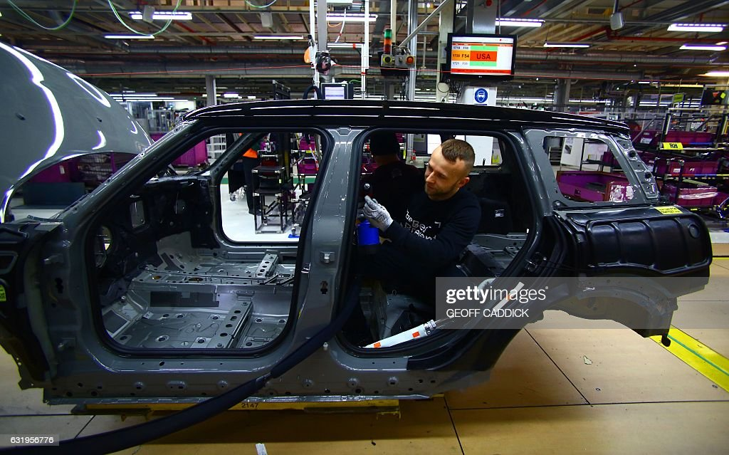an employee fits the wiring loom to a mini at the bmw mini car rh gettyimages com bmw mini cooper wiring diagram bmw mini wiring diagram download