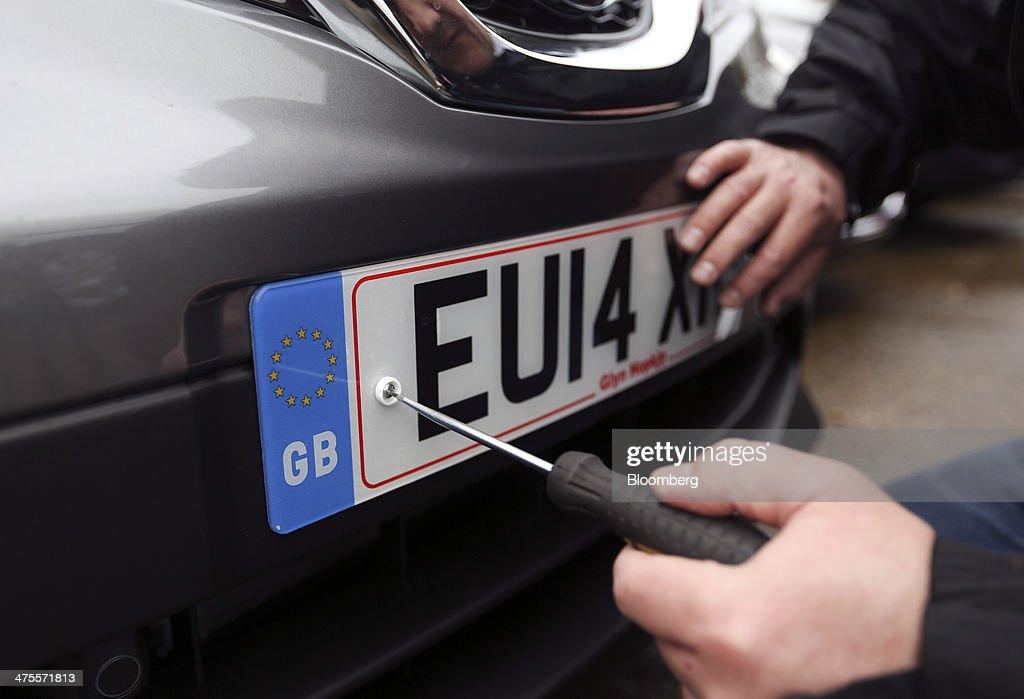New 2014 U.K. Car Registration Plates Prepared For First Customer Deliveries : News Photo