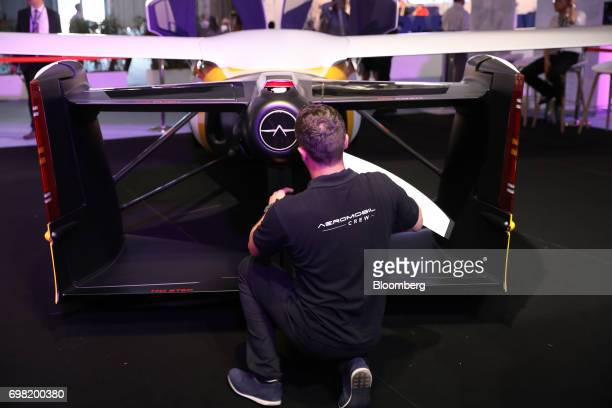 An employee fixes a propeller to an AeroMobil flying car as it stands on display during the 53rd International Paris Air Show at Le Bourget in Paris...