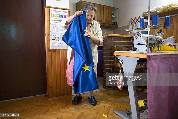 An employee folds a new European Union flag ready for dispatch from the Prvi BarjakMatic factory as Croatia prepares to join the European Union in...
