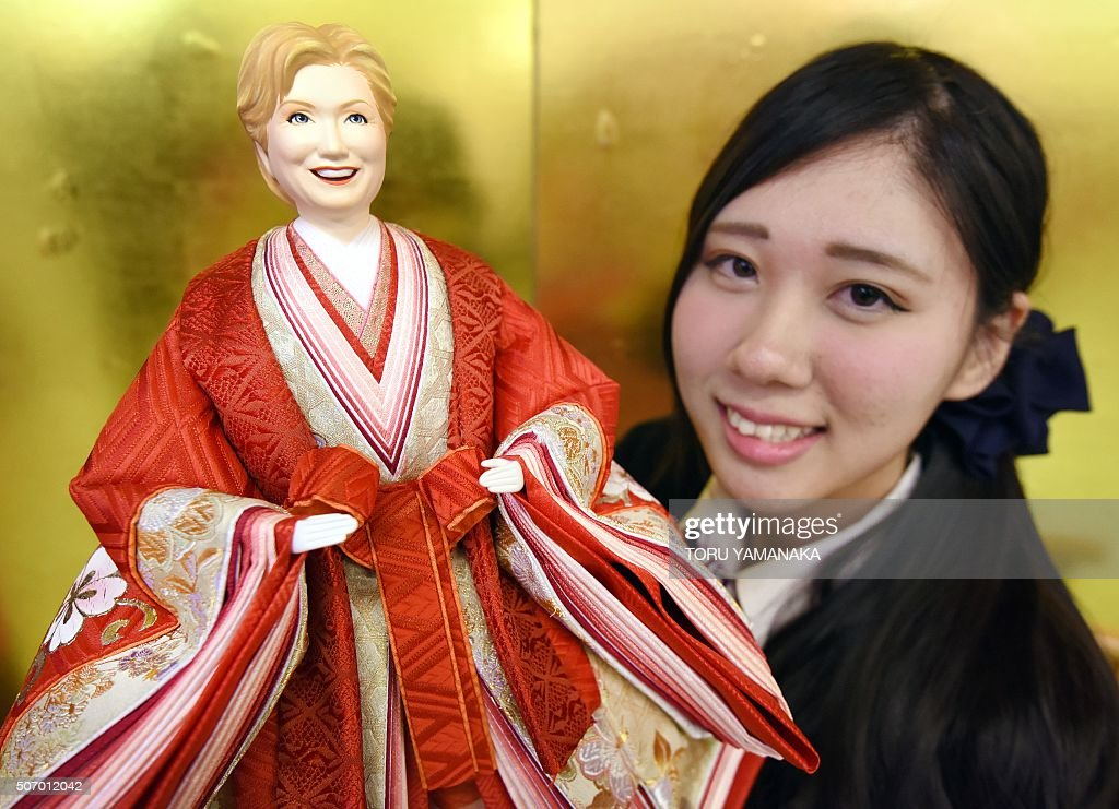 An employee for Japanese doll maker Kyugetsu unveils a