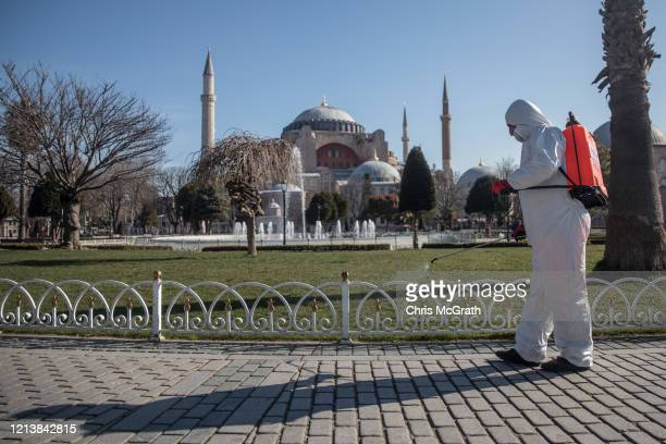 An employee from Istanbul Municipality disinfects areas in front of Hagia Sophia on March 21 2020 in Istanbul Turkey Turkey has confirmed nine deaths...