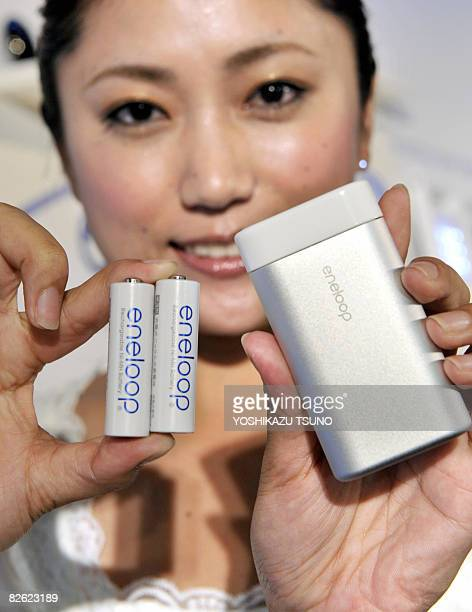 An employee from Japan's electronics giant Sanyo displays a new rechargeable hand warmer 'eneloop kairo' powered by AAsized eneloop rechargeable...