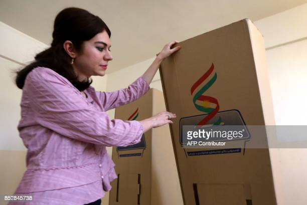 An employee from the Independent High Electoral Referendum Commission prepares the voting station ahead of tomorrow's planned referendum for the...