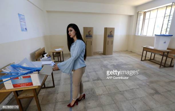 An employee from the Independent High Electoral Referendum Commission prepares ballot boxes at a voting station ahead of tomorrow's planned...