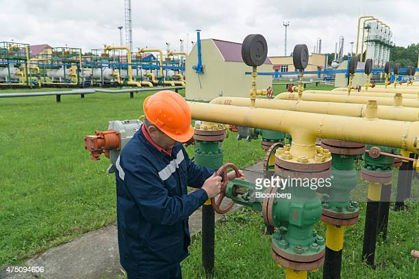 An employee from UkrTransGaz works on gas pipes at the Dashava underground gas storage facility operated by UkrTransGaz a unit of NAK Naftogaz...