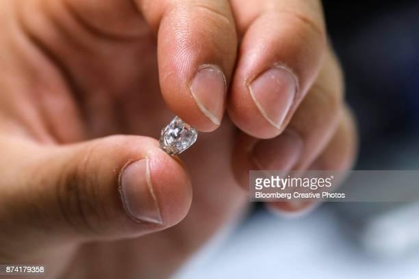 An employee handles a rough diamond