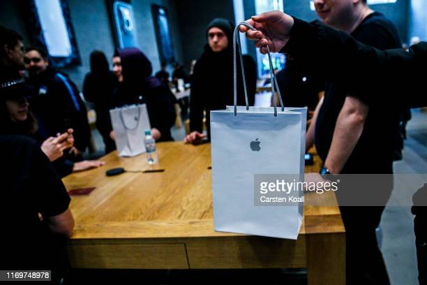 An employee hands in the new Apple iPhone 11 on the first day of the phone's sale at the Apple Store on September 20 2019 in Berlin Germany The new...
