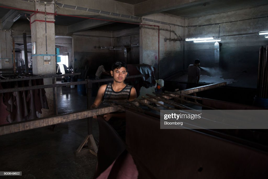 An employee hangs a sheet of leather to dry at the Sheong Shi Tannery in Kolkata, West Bengal, India on Tuesday, Dec. 26, 2017. India's manufacturing sector grew in December as the Nikkei India Manufacturing Purchasing Managers' Index (PMI) rose to 54.7 from 52.6 in November, with a number above 50 indicating expansion. Photographer: Taylor Weidman/Bloomberg via Getty Images