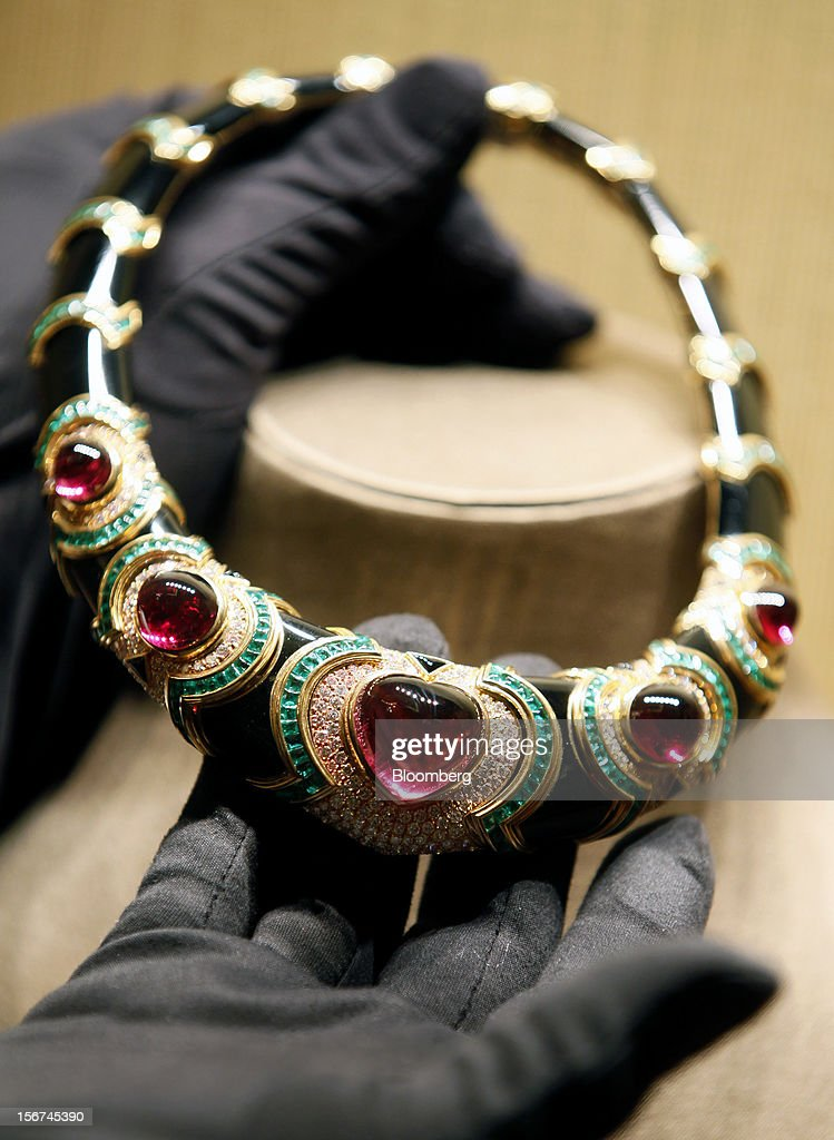 An employee holds a Bulgari Heritage Collection necklace in gold, red tourmaline, emerald, onyx and diamond in this arranged photograph inside Bulgari SpA's store, a luxury unit of LVMH Moet Hennessy Louis Vuitton SA, in Rome, Italy, on Monday, Nov. 19, 2012. Last year's acquisition of Bulgari 'has brought a lot of jewelry know-how' to the company, said Francesco Trapani, president of LVMH's watch and jewelry division, who joined the Paris- based luxury-goods maker as part of the deal. Photographer: Alessia Pierdomenico/Bloomberg via Getty Images