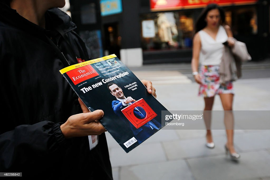 An employee holds a copy of The Economist magazine during a promotional subscription event in London, U.K., on Wednesday, July 29, 2015. Pearson Plc moved closer to an exit from business publishing as it announced plans to dispose of its stake in the 172-year-old Economist magazine, just days after the sale of the Financial Times newspaper. Photographer: Simon Dawson/Bloomberg via Getty Images