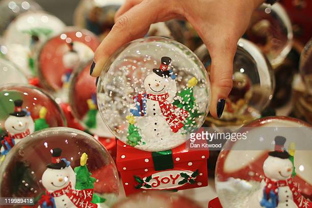 An employee holds a decoration in the Christmas shop at Selfridges department store on July 28 2011 in London England Selfridges launched its...
