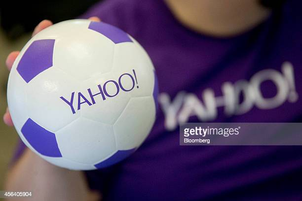 An employee holds a Yahoo branded soccer ball for a photograph in the Global Service Desk area of the company's Lockport Data Center in Lockport New...