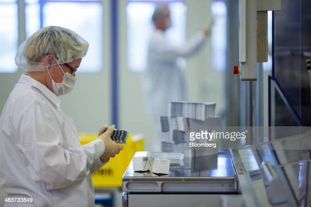 An employee holds blister packs of Aliud Pharma GmbH Torasemid AL high blood pressure tablets at the Stada Arzneimittel AG pharmaceutical factory in...