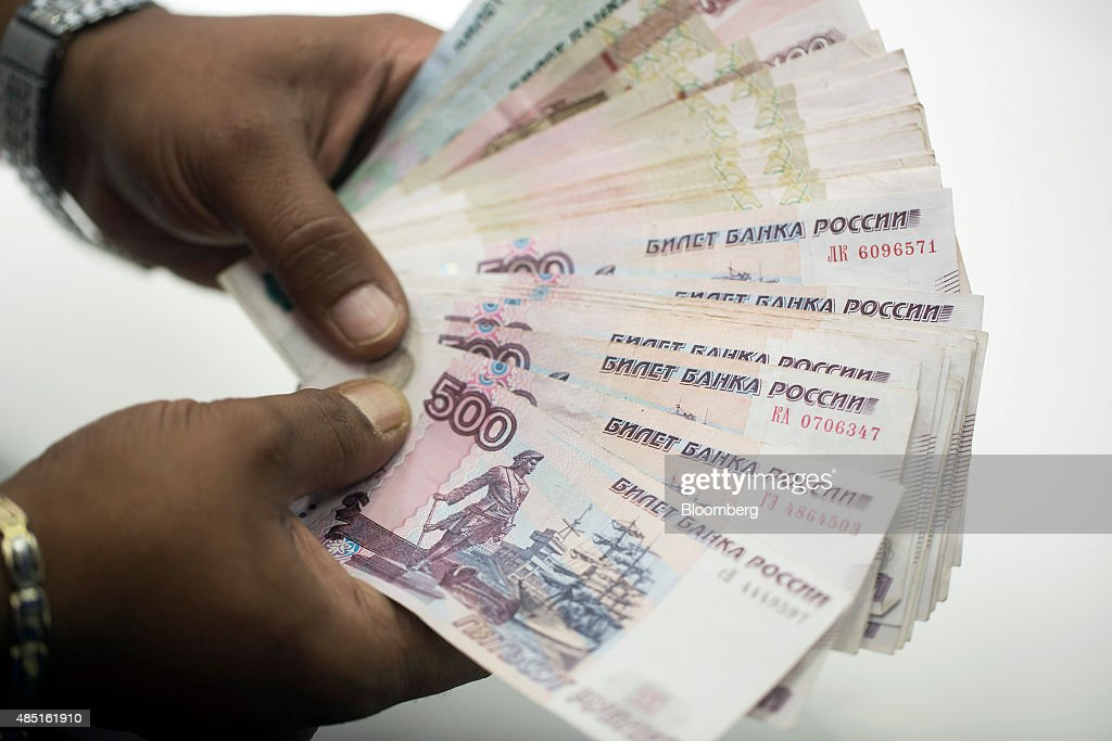 An employee holds five hundred Russian Ruble notes in this arranged photograph in London, U.K., on Monday, Aug. 24, 2015. The plunge in the ruble is deepening divides within the free-trade project promoted by Russian President Vladimir Putin to bind former Soviet republics together. Photographer: Jason Alden/Bloomberg via Getty Images