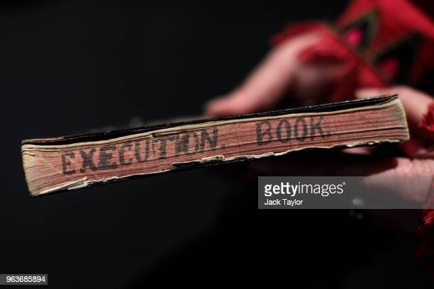 An employee holds hangman Henry Pierrepoint's execution notebook from a collection of crime memorabilia linked to his son and executioner Albert...
