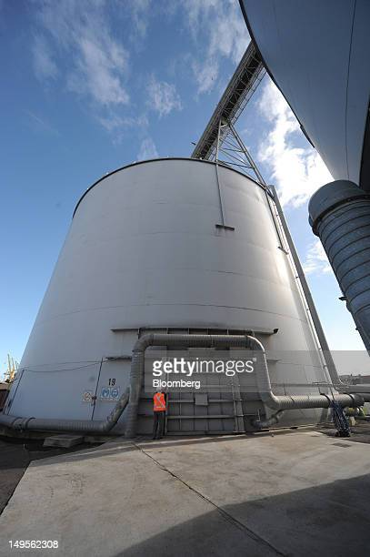 An employee inspects a door lock on a wheat silo at Emerald Group Australia Pty's Melbourne Port Terminal in Melbourne Australia on Monday July 30...