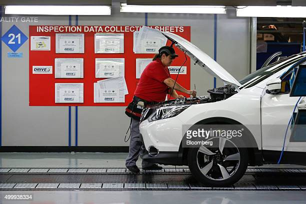 An employee inspects a Nissan Qashqai on the production line at the Nissan Motor Co production plant in Sunderland UK on Thursday Dec 3 2015 Nissan...