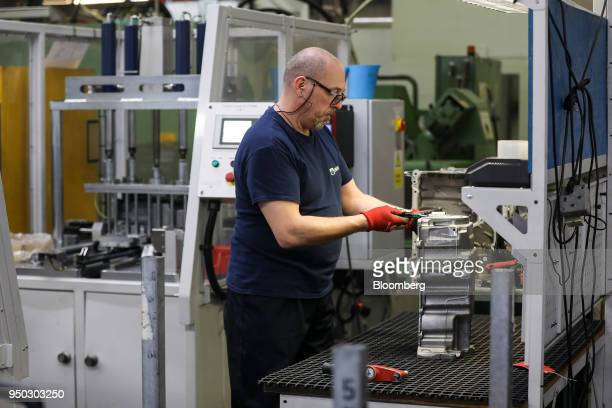 An employee inspects a panther ladder frame at Liberty Aluminium Technologies in Coventry UK on Monday April 23 2018 Aluminum markets are still...