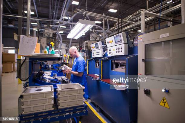 An employee inspects a vinyl record at the Precision Record Pressing facility in Burlington Ontario Canada on Friday June 30 2017 Precision is the...