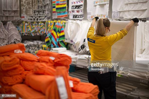 An employee inspects a white towel in the Ikea AB retail store in Khimki Russia on Monday Oct 3 2016 Ikea's Russia unit may spend 100 billion rubles...