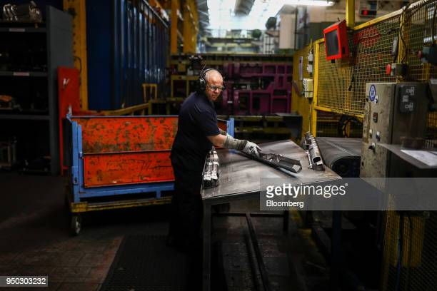 An employee inspects aluminium metal at Liberty Pressing Solutions in Coventry UK on Monday April 23 2018 Aluminum markets are still reeling from US...