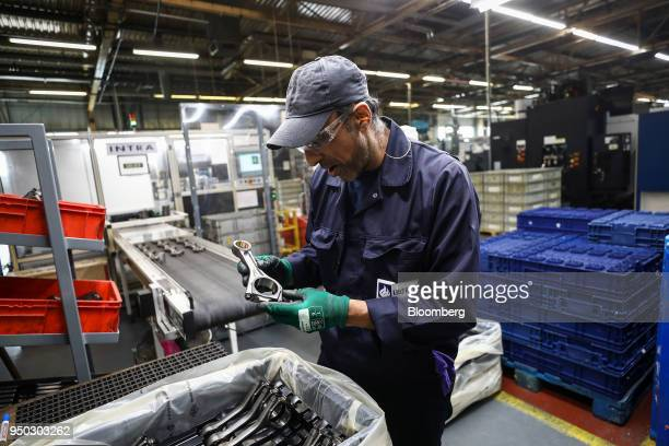 An employee inspects connecting rods at Liberty Aluminium Technologies in Coventry UK on Monday April 23 2018 Aluminum markets are still reeling from...