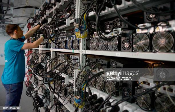 "An employee inspects machines for the production of bitcoins and lightcoins at the ""Kriptounivers"" mining centre during a presentation of the largest..."