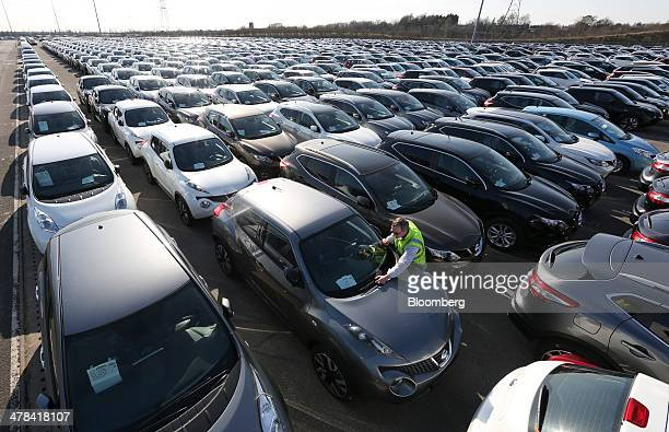 An employee inspects new Nissan automobiles produced by Nissan Motor Co at the Port of Tyne South Shields UK on Wednesday March 12 2014 About 80...