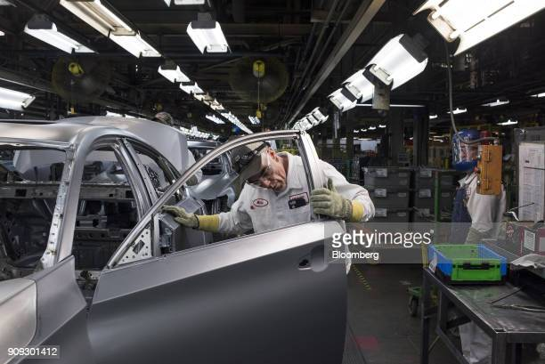 An employee inspects the door of a 2018 Honda Accord vehicle during production at the Honda of America Manufacturing Inc Marysville Auto Plant in...