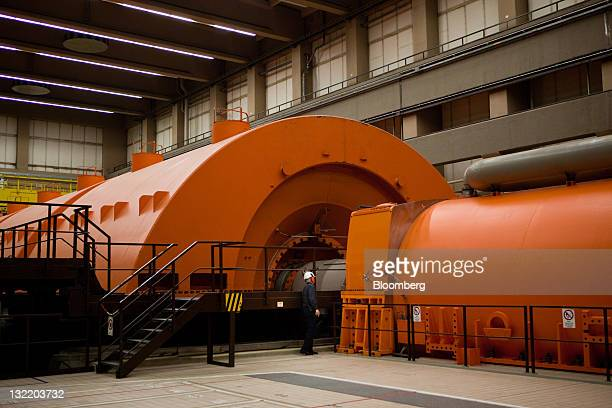An employee inspects the electrical generator at the EON AG nuclear power plant in Grohnde Germany on Wednesday Nov 9 2011 Data from EON AG and RWE...